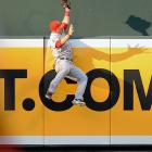 """Only two months after he arrived in """"The Show"""" and began one of the best rookie seasons in baseball history, Mike Trout made perhaps of the catch of the year on June 27, 2012 when he leapt to snag a sure homer away from the Orioles' J.J. Hardy."""