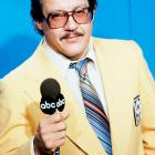Alex Karras poses with a mic on Nov. 24, 1976 while working as a commentator for Monday Night Football.