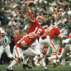 """After the Chiefs take a 16-0 lead into halftime, a 46-yard touchdown pass from Len Dawson to Otis Taylor seals a Super Bowl IV victory as the Chiefs beat the Vikings, 23-7. This is the game where Kansas City coach Hank Stram, miked up for NFL Films, calls for the famous """"65 toss power trap"""" play and urges the Chiefs to """"keep matriculating the ball downfield."""""""