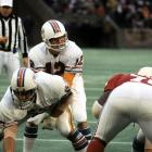 Bob Griese passes for six touchdowns and the Dolphins set a franchise record for points in a single game in lambasting the Cardinals 55-14 on Thanksgiving Day in St. Louis.