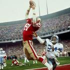 """Facing third-and-3 at the Dallas 6-yard line with 58 seconds left and his team trailing, 27-21, quarterback Joe Montana rolls out to his right and throws a high pass into the back of the end zone, where Dwight Clark makes a leaping, game-winning reception in the NFC championship game. The play will forever be known as """"The Catch,"""" and it represents the beginning of the 49ers' rise as a Super Bowl power."""
