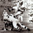 Led by former UCLA star and T-Formation quarterback Bob Waterfield, the Cleveland Rams beat the Redskins, 15-14, in the NFL championship game on an icy field in Cleveland. Waterfield (pictured here in a different game) is the first player to be voted unanimously as the league's MVP.