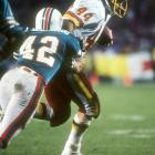 """John Riggins' Super Bowl record 166 yards rushing and fourth-quarter 43-yard touchdown burst on a fourth-and-one call give the Redskins their first Super Bowl crown and first NFL championship in 40 years, a 27-17 win over the Miami Dolphins. Washington's famed """"Hogs"""" offensive line pulverized the Miami defense for 276 yards rushing."""