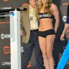Rousey approaches the scale during the weigh-in for her fight against Miesha Tate.