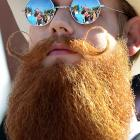 The third annual National Beard and Moustache Championships were held in Las Vegas on Nov. 11, with Patrick Fette of Louisville (frame 4) winning the English Moustache category.