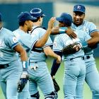 Jackson hugs Kansas City teammate Tom Gordon after a win over the Mariners. 1989 would be Jackson's best year in baseball, as he hit a career-high 32 home runs.