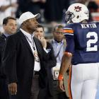 Auburn quarterback gets some advice from alumnus Jackson during the 2011 BCS National Championship Game in Glendale, Arizona. That night Auburn won its second national title in school history.