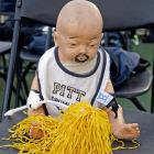 Shocking evidence that steroids and growth hormones in baby food are causing even the most tender tots to sprout facial hair, which leads to out-of-the-crib recruitment by major college athletic programs.