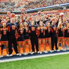 "Players and cheerleaders lustily warble the alma mater ""Orange You Happy"" after a 45-26 win over the Louisville Cardinals at the Carrier Dome."
