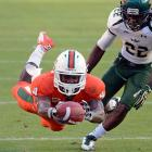 Another reason for South Florida fans to break out the paper bags: a Miami wideout sailing toward the end zone in the Hurricanes' 40-9 win at Sun Life Stadium.