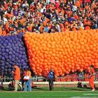 The Memorial Stadium crew makes a balloon payment before the Tigers' 62-48 home win.
