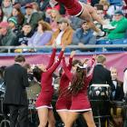 With the t-shirt cannon out of commission, cheerleaders are tossed into the crowd at Gillette Stadium, a reasonable reward for sitting through a 42-21 loss to the Central Michigan Chippewas.