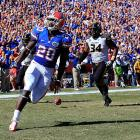 It wasn't particularly pretty, but Florida escaped with a narrow win against SEC newcomer Missouri. One week after watching their unbeaten season slip away, the Gators came out flat and trailed the Tigers heading into the half. But they responded after the break. Omarius Hines (pictured) ripped off a 36-yard touchdown run, and Mike Gillislee caught a 45-yard touchdown pass from Jeff Driskel. Missouri quarterback James Franklin's struggles persisted. He overthrew several wide-open receivers and finished the day with four interceptions.