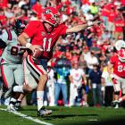 Georgia showed off its potent aerial attack to move one step closer to an SEC East title. Despite trailing Ole Miss at the end of the first quarter, the Bulldogs rolled to victory behind a 384-yard, four-touchdown performance from quarterback Aaron Murray (pictured). Star freshman running back Todd Gurley finished with 18 carries for 117 yards, and receiver Marlon Brown made three catches for 113 yards and a score. Mark Richt's team has just one game left on its SEC schedule, a trip to 2-7 Auburn next Saturday.