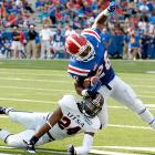 For the seventh time this season, Louisiana Tech finished the game with more than 50 points. Bulldogs' standouts Colby Cameron and Quinton Patton had their way with UTSA. Cameron finished 30-of-39 with 348 yards and three touchdowns, and Patton made 10 grabs for 152 yards and a score. Running back Kenneth Dixon (pictured) also did his part. The freshman found the end zone three times, ending the day with 18 carries for 72 yards.