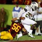 Oregon's offense showed why it may be the most feared unit in the nation. The Ducks hung 62 points on USC, an effort that had no shortage of standouts: Marcus Mariota passed for 306 yards and four touchdowns and Josh Huff made six catches for 125 yards and two scores. Still, the real star of the day was Kenjon Barner (pictured). The senior running back galloped for an eye-popping 324 yards and five touchdowns, a performance that overshadowed big games from the Trojans' Matt Barkley, Marqise Lee and Nelson Agholor.