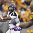 West Virginia's fall from grace continues. Just a few weeks after enjoying a top-five national ranking, the Mountaineers have now lost three consecutive games. Geno Smith threw for 254 yards and three touchdowns, but TCU counterpart Trevone Boykin (pictured) emerged victorious after hitting Josh Boyce -- who finished with 181 receiving yards and two scores -- for the game-winning two-point conversion in double overtime. Horned Frogs wideout Brandon Carter completed a 25-yard pass to Corey Fuller to set it up.
