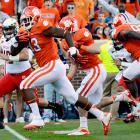Clemson just keeps on rolling. The Tigers won their sixth straight game by pummeling Maryland at home. Tajh Boyd passed for 260 yards and three touchdowns, and wideout DeAndre Hopkins corralled his 14th scoring grab of the season. Sophomore defensive end Corey Crawford (pictured) joined in on the scoring with a 16-yard fumble recovery for a touchdown in the first quarter.