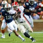 Georgia is heading back to the SEC championship game. Much to Florida's dismay, the Bulldogs clinched their claim to the SEC East with a shutout of Auburn, a contest which Georgia controlled from the opening kick. Aaron Murray threw for 208 yards and three touchdowns, freshman backs Todd Gurley and Keith Marshall (pictured) combined for 221 yards and two scores and Malcolm Mitchell led the receivers with 47 yards and a touchdown. Perhaps most telling: The Bulldogs outgained the Tigers 497-238.