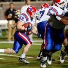 Like points? This game was for you. Louisiana Tech's Ray Holley (pictured) rushed 27 times for 145 yards and a touchdown, teammate Kenneth Dixon added 21 carries for 144 yards and four touchdowns and the Bulldogs survived a shootout and avoided taking a second loss.