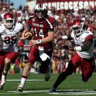 South Carolina was without injured running back Marcus Lattimore, but the offense didn't miss a beat against Arkansas. Connor Shaw (pictured) accounted for 282 yards and three touchdowns, Mike Davis and Kenny Miles combined for 90 rushing yards and a score and the Gamecocks took down the Razorbacks in Week 11. The defense also did its part. D.J. Swearinger added a 69-yard pick-six in the third quarter.
