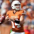 The Longhorns opened the game with a wishbone formation tribute to former coach Darrell Royal, and they ended it with a Big 12 rout of Iowa State. Mack Brown's squad raced out to a 14-0 first-quarter lead and never looked back to improve to 8-2. David Ash (pictured) completed 25-of-31 attempts for 364 yards and two touchdowns, while freshman running back Johnathan Gray carried 14 times for 74 yards and two scores. The oft-maligned Texas defense held the Cyclones to just 277 total yards.