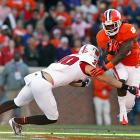 NC State simply had no answer for Clemson's offense -- and quarterback Tajh Boyd, in particular. Boyd accounted for a school-record 531 yards and eight touchdowns, and the Tigers racked up 754 yards of total offense in taking down the Wolfpack. Andre Ellington (pictured) and Sammy Watkins also delivered memorable performances. Ellington carried 22 times for 124 yards, while Watkins made 11 receptions for 110 yards and a score.
