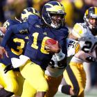This was a bitter-sweet win for Michigan. The Wolverines improved to 8-3 overall and 6-1 in Big Ten play thanks to a six-touchdown day from quarterback Devin Gardner, who passed for three scores and rushed for three more. But the Wolverines lost running back Fitzgerald Toussaint to a gruesome leg injury on the opening drive. They got help in the backfield from a surprising source, though. After missing two-plus games with an injury to his throwing elbow, Denard Robinson played -- just not at quarterback. Robinson (pictured) rushed 13 times for 98 yards and caught two passes for 24 yards.