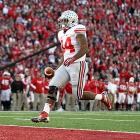After edging past Wisconsin in Madison, the Buckeyes are just one win away from going undefeated in their first season under Urban Meyer. Though Braxton Miller was held in check, running back Carlos Hyde (pictured) rushed for 87 yards and two touchdowns, including the game-winning score on the third play of overtime. Meanwhile, Badgers back Montee Ball tied the major-college record with his 78th career touchdown in the second quarter. He can take sole possession of first place with one score next week at Penn State.