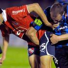 """This is what soccer folks mean by """"a friendly"""" -- in this case a match between Argentina Independiente and Uruguay Liverpool."""
