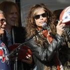 "At a free concert on Commonwealth Avenue, the New England Patriots' owner offers a pigskin salute to Boston's most ancient and revered musical artifact. It was there, on that very spot in April 1775 that Aerosmith first cranked out ""Walk This Way"", prompting the British to invade."