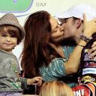 "Taking the buss: ""Ewww. Mom and Dad are swappin' spit,"" little Leo Gordon is obviously thinking after his papa won Ford EcoBoost 400 at Homestead-Miami Speedway."