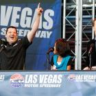 "A jubilant Tony Stewart smokes his competition in an ""Are You Smarter than a Fifth Grader?"" event at the NASCAR Champions Week Fanfest in Las Vegas while the fifth grader in question, Maria, looks on in astonishment."