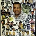 A poster honoring boxing trainer Steward and the boxers he trained is seen in the trainer's office.