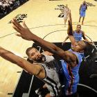 Tim Duncan goes heads up against the Thunder's Serge Ibaka. The Spurs knocked off Oklahoma City on a Tony Parker buzzer beater.
