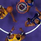 Kobe Bryant appears to have a jump on Dwight Howard and two Clippers during the Lakers' 105-95 loss to their L.A. rival. The loss dropped the Lakers to 0-3, but they have since defeated Detroit to get their first win of the year.