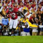 Alabama's Eddie Lacy breaks loose and eludes the LSU defense.