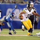 Steelers' running back Isaac Redman carves out a lane during Pittsburgh's win over the New York Giants.
