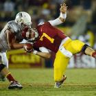USC's Matt Barkley is yanked down by an Oregon defender during the Ducks' 62-51 victory in Los Angeles. The AP's preseason No. 1 team, USC is now 6-3.