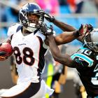 The Broncos' Demaryius Thomas stiff-arms the Panthers' Charles Godfrey during Denver's 36-14 win over Carolina.