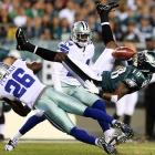 The Eagles' Jeremy Maclin has the ball jarred loose by the Cowboys' Charlie Peprah during the Cowboys' pivotal victory over the Eagles.