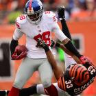 The Bengals' Chris Crocker tries to yank down the Giants' Hakeem Nicks by his jersey. It was one of the tougher plays that the Bengals faced all day as they coasted to a 31-13 victory over the defending Super Bowl champions.
