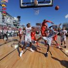 Syracuse forward James Southerland delivers a rejection near the basket during the Battle on the Midway against San Diego State.