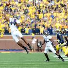 Northwestern wide receiver Christian Jones pulls down a first-quarter pass during Saturday's clash against Michigan at Michigan Stadium. UM came back to beat the Wildcats 38-31 in overtime.