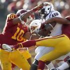 USC linebacker Hays Pullard (10) helps teammate T.J. McDonald (7) pull down an Arizona State receiver during the Trojans' 43-22 win.
