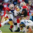 Rams' running back Steven Jackson is tackled by 49ers cornerback Chris Culliver (29) and linebacker Patrick Willis (52) and loses his helmet during the 24-24 tie. It was the first tie in the NFL since 2008.