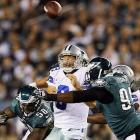The Eagles' Fletcher Cox and Trent Cole harass Cowboys' quarterback Tony Romo during Dallas's 38-23 win over Philadelphia in Week 10.