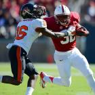 Stanford's Anthony Wilkerson delivers a stiff arm during the Cardinal's Saturday tilt with Oregon State. Stanford would turn a key fumble by Beavers' quarterback Cody Vaz into a touchdown and survive 27-23.
