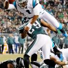 Cam Newton hurdles over Eagles safety Nate Allen during the Panthers' 30-22 win on Monday Night football.