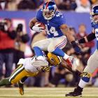 Running back Ahmad Bradshaw evades a diving Packers defender. Bradshaw finished the day with 61 yards, as the Giants came away with an easy 38-10 victory over Green Bay.